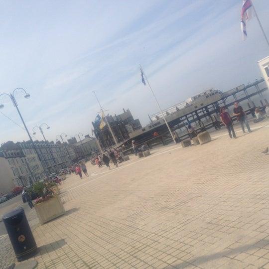 Photo taken at Aberystwyth Beach by Gordon B. on 7/21/2012