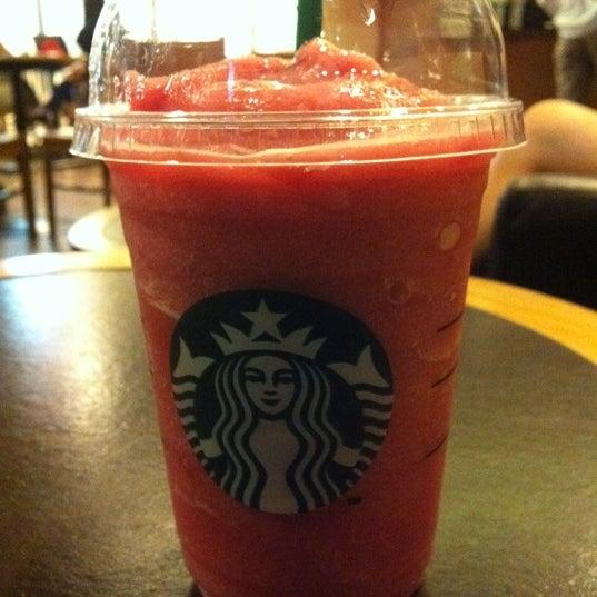 Photo taken at Starbucks by Natthakarn B. on 3/25/2011