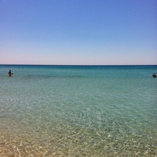 Photo taken at Ramo Beach by Burak Ö. on 7/16/2012