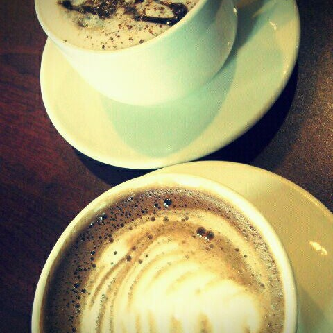 Photo taken at Arcedium Coffeehouse Inc by Bekah G. on 10/18/2011