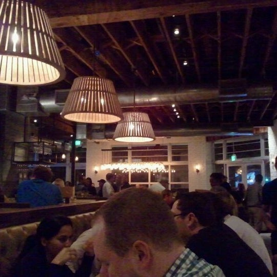 Photo taken at Yardbird Southern Table & Bar by Buena Vista Supper Club on 10/10/2011