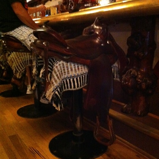 Photo taken at Million Dollar Cowboy Bar by Jaclyn W. on 9/26/2011