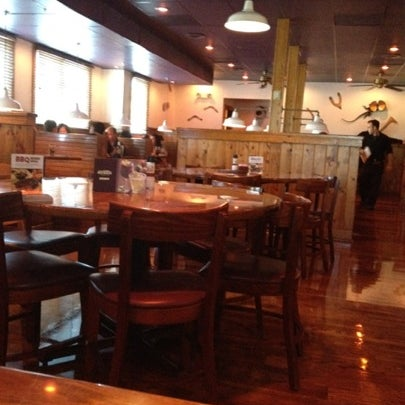 Photo taken at Outback Steakhouse by Mike G. on 7/28/2012