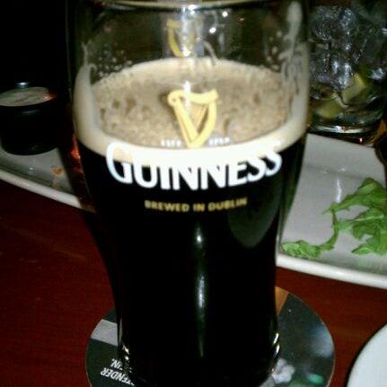 Photo taken at Fado Irish Pub & Restaurant by Darcie B. on 11/12/2011