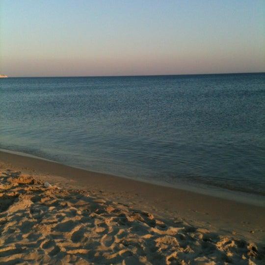 Photo taken at Ramo Beach by Mutlu on 8/5/2012
