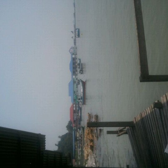 Photo taken at Teluk Tempoyak by Chariss L. on 9/13/2011