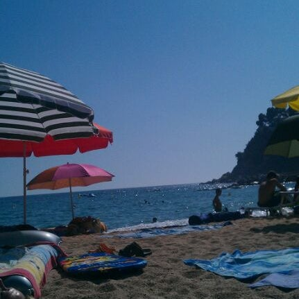 Photo taken at Canyelles Beach by Òscar P. on 8/20/2011