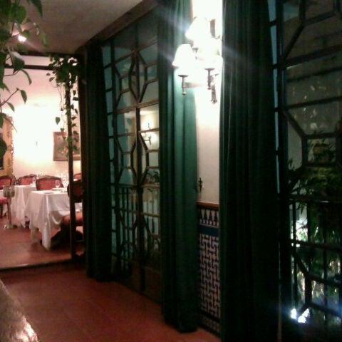 Photo taken at Restaurante El Caballo Rojo by Dani B. on 12/27/2011