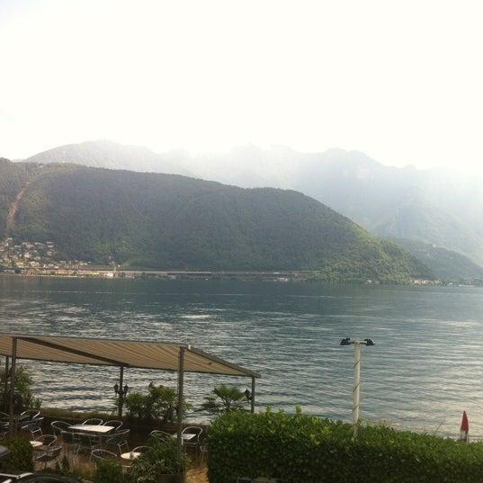 Photo taken at Lago di Lugano by Khalid N. on 7/13/2012