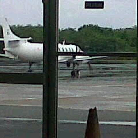 Photo taken at A.N.R. Robinson International Airport (TAB) by Krystal L. on 8/2/2012