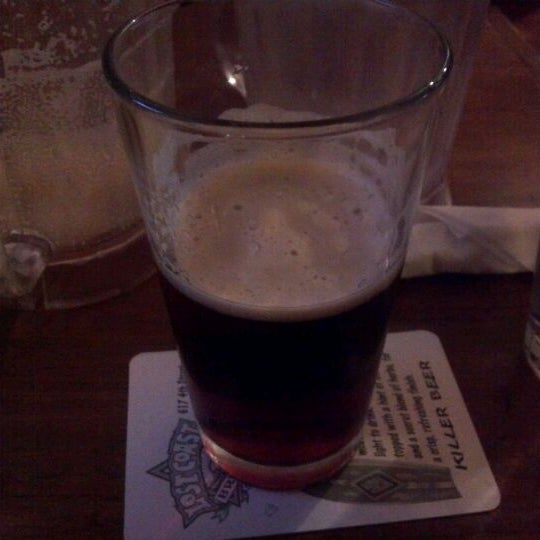 Photo taken at 99 Bottles of Beer on the Wall by Mark E. on 12/9/2011