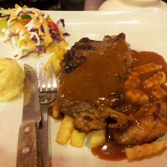 Photo taken at De Pauh Garden Restaurant & Cafe by Salman A. on 6/6/2012