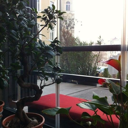 Photo taken at Komün by Mujde O. on 3/24/2012
