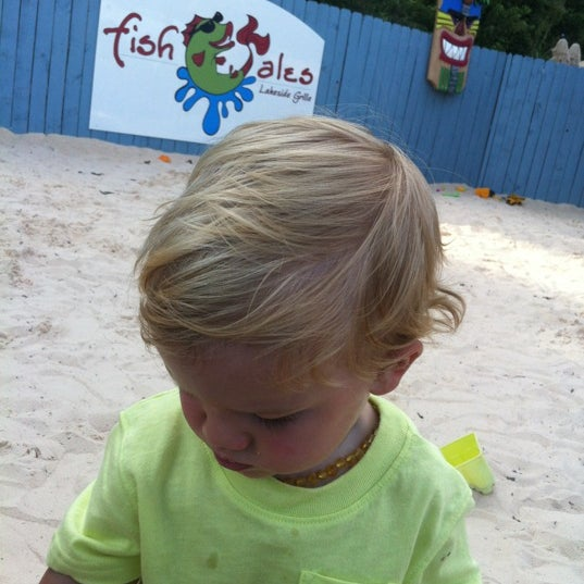 Photo taken at Fish Tales Lakeside Grille by Brandon M. on 7/6/2012