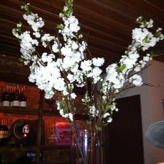 Photo taken at Custom Wine Bar by Sarah L. on 5/6/2011