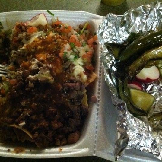 Photo taken at Establos Meat Market by Minnelli J. on 11/30/2011
