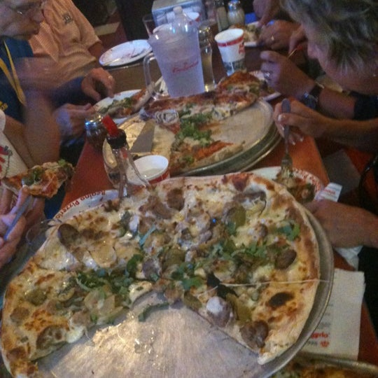 Photo taken at Regina Pizzeria by Kristen G. on 4/16/2012