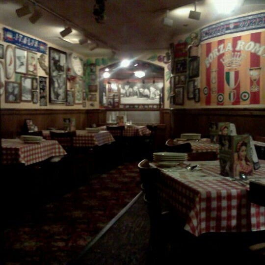Photo taken at Buca di Beppo by Nick T. on 8/18/2011