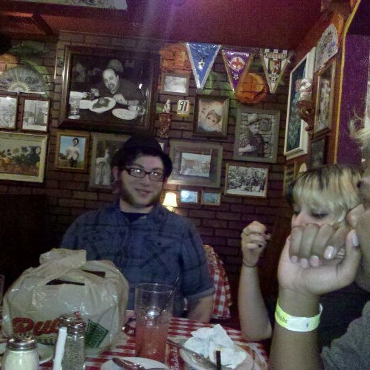 Photo taken at Buca di Beppo by Darian C. on 12/12/2011