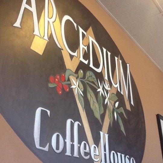 Photo taken at Arcedium Coffeehouse Inc by David D. on 1/28/2012