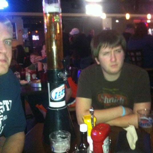 Photo taken at Scoreboards Pub & Grill by Andrew K. on 3/29/2012