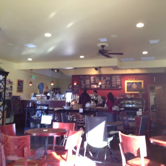 Photo taken at Kunjani Coffea by Brad J. on 3/31/2012