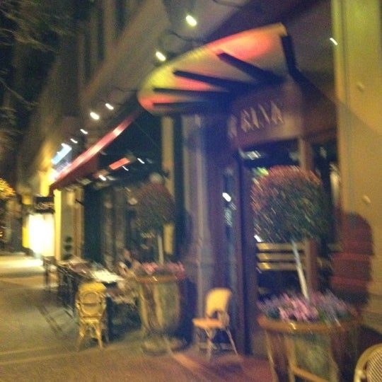 Photo taken at Left Bank Brasserie by Huib S. on 4/2/2012