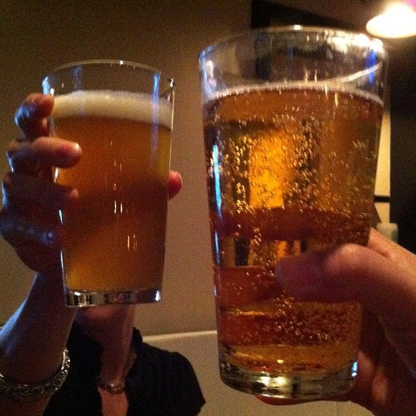 Photo taken at Pint + Jigger by Melissa C. on 7/25/2012