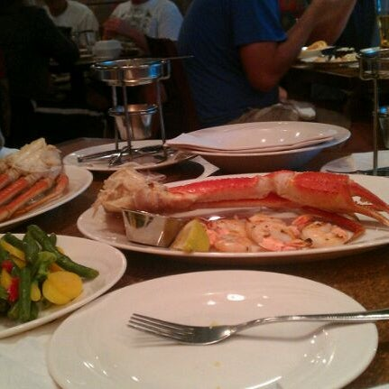 Photo taken at North and South Seafood & Smokehouse by S X. on 7/11/2012