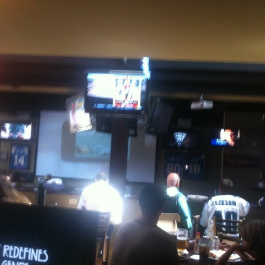 Photo taken at Stadium Sports Bar & Restaurant by Eric M. on 10/2/2011