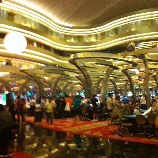 Photo taken at Marina Bay Sands Casino by Rafeeq R. on 4/28/2012