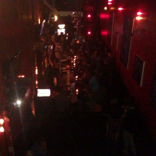 Photo taken at The SKINnY Bar & Lounge by Matt F. on 10/14/2011
