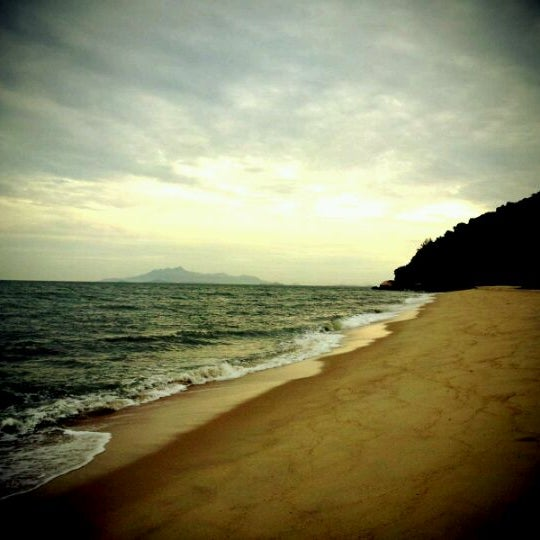 Photo taken at Teluk Bahang Beach by Jien H. on 1/28/2012
