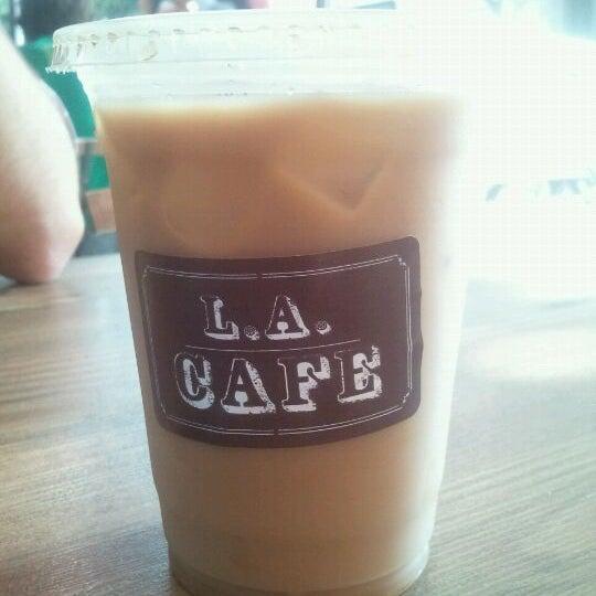 Photo taken at LA Café by Kellee V. on 9/30/2011
