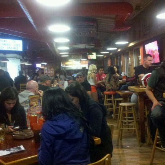 Photo taken at Hooters of Ontario by Stella A. on 1/23/2012