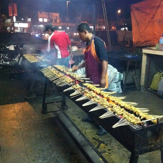 Photo taken at Satay Hut by Lisa S. on 12/25/2011
