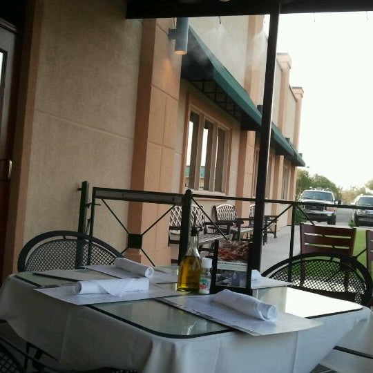 Photo taken at Carrabba's Italian Grill by Ivan A. on 6/2/2012