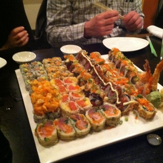 Photo taken at Masamoto Sushi & Asian Grill by Tyler S. on 3/11/2011