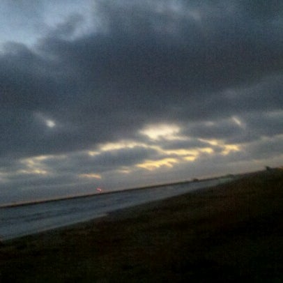 Photo taken at Lifeguard Tower 12 by Steve F. on 7/1/2012