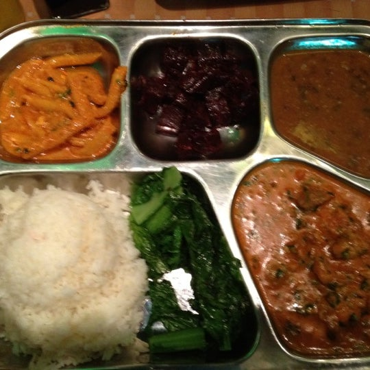 Photo taken at Cafe Tibet by Ammu K. on 3/1/2012