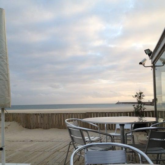 Photo taken at Praia do Titan by Lena R. on 4/23/2012