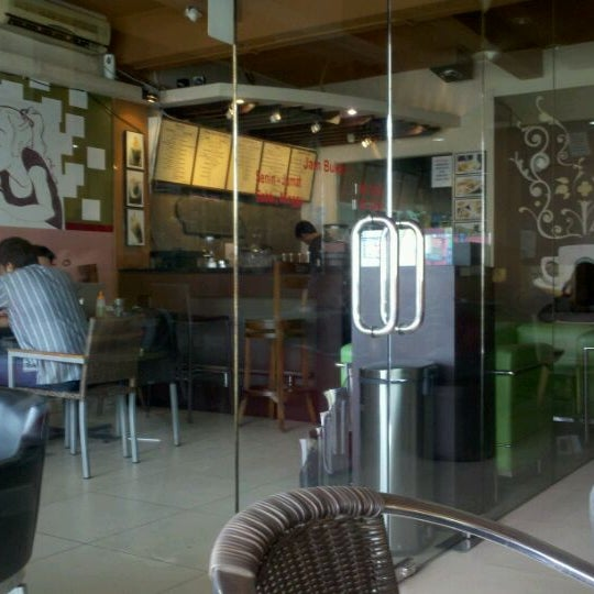 Photo taken at CoffeeBen's & Resto by Adrianto D. on 1/4/2012