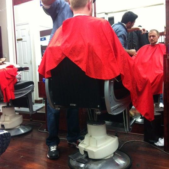 Photo taken at Manhattan Barber Shop by Alex C. on 12/8/2011