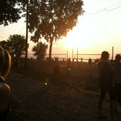 Photo taken at Whiskey Island Volleyball Courts by Kim on 8/3/2012
