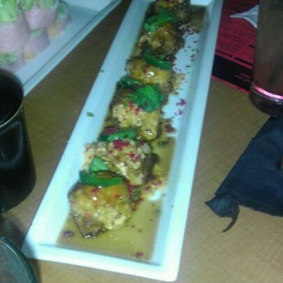 Photo taken at RA Sushi by Marcia C. on 10/2/2011