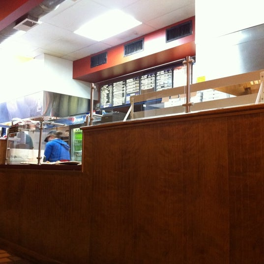 Photo taken at Burke Street Pizza by Cameron A. on 1/20/2011