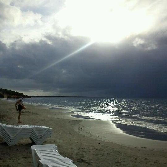Photo taken at Playa El Yaque by choco p. on 2/22/2012