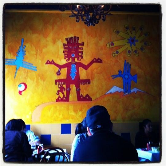 Photo taken at Pio Pio by Emmanuela A. on 4/26/2012