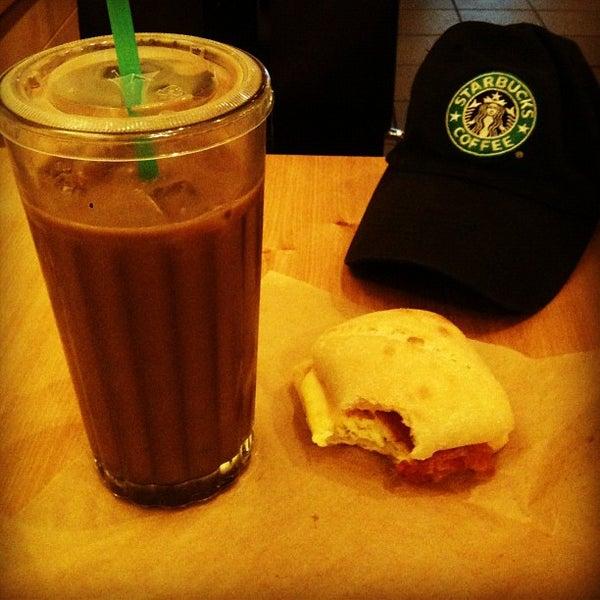Photo taken at Starbucks by carlos v. on 8/4/2012