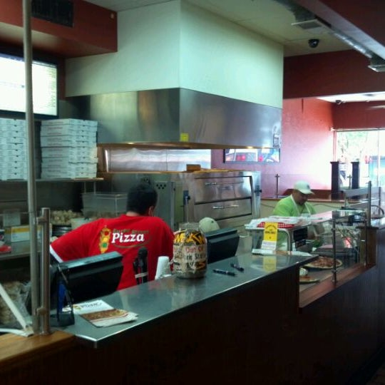 Photo taken at Burke Street Pizza by Jerry R. on 5/18/2012